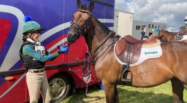 Girl and Horse getting ready for competing