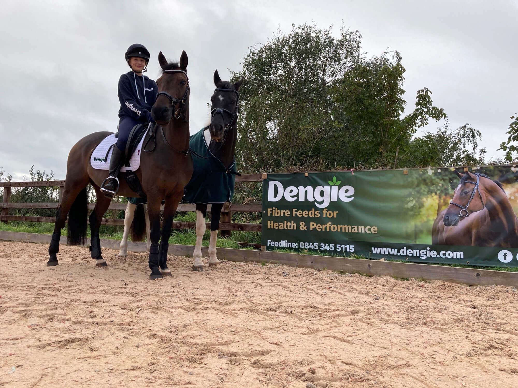 Horses next to Dengie banner
