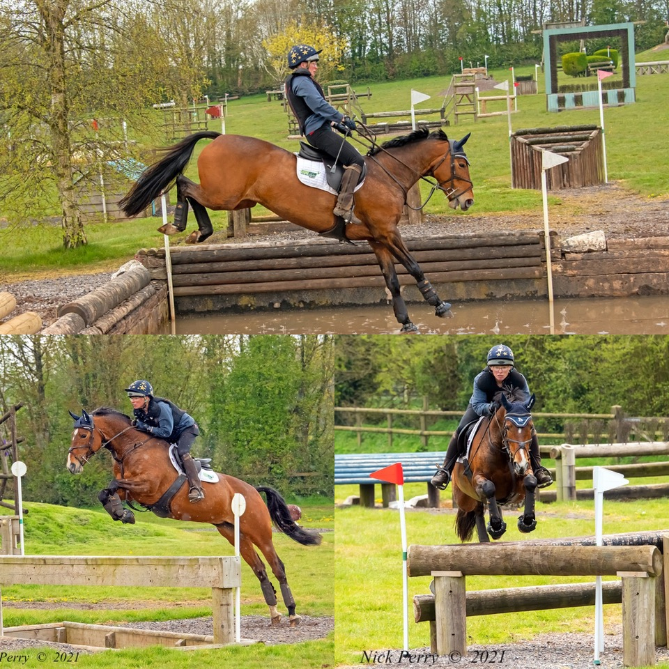 Horse and rider jumping cross country